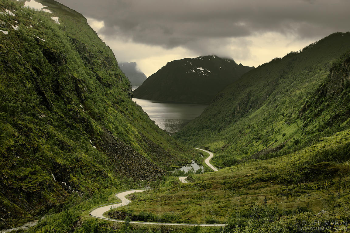 Road in deep valley and fjord