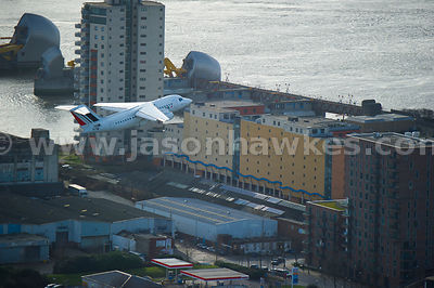 Aerial view of plane taking off from City Airport, London