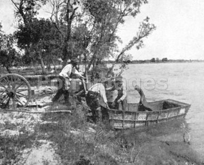 Pioneers in Ezra Meeker group launch schooner on river