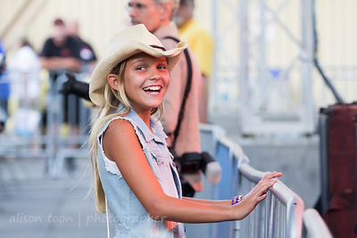 Young fan watching Chase Rice