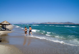 People running along Tingaki Beach, Tingaki, Kos Island, Greece.
