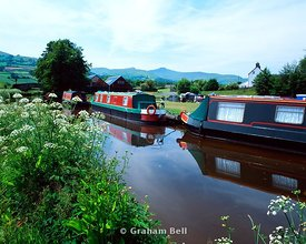 barges on monmouthshire and brecon canal llanfrynach wharf near brecon with the brecon beacons in the distance wales