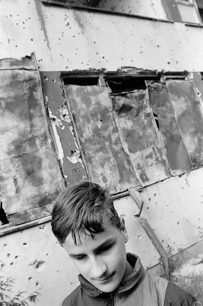 A boy amidst the ruins at the Blind School