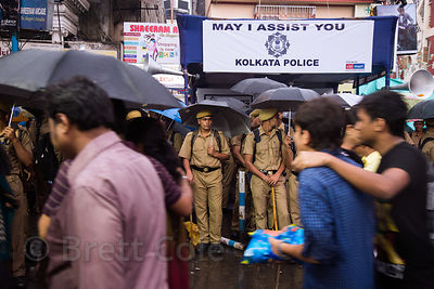 Police in monsoon rains, Newmarket, Kolkata, India