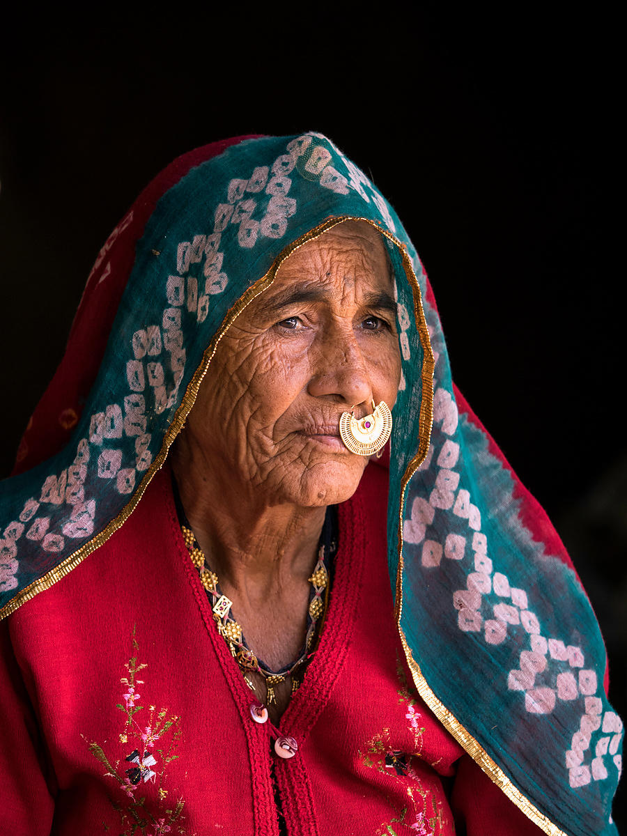 A dressed up rajasthani rural woman posing for a portrait