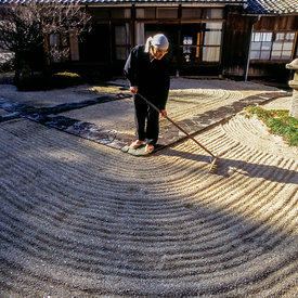A Zen monk of the Soto School rakes a sand garden as part of meditative practice at the Seiryu-ji Temple in Hikone City