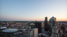 Medium Moving Shot: Full Sunset & Blue Hour Above Kansas City's Lit Skyline