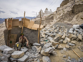 A construction worker takes a break from work and rests. This photograph was taken in Ladakh.