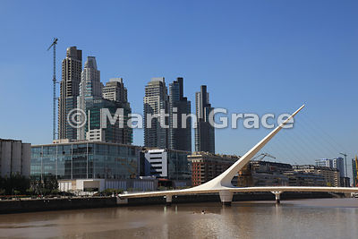 Puente de la Mujer (Woman Bridge) in Puerto Madero docklands regeneration in Buenos Aires, Argentina, with high rise buildings and canoe