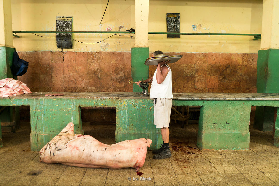 A butcher at a local market in Havana, Cuba.