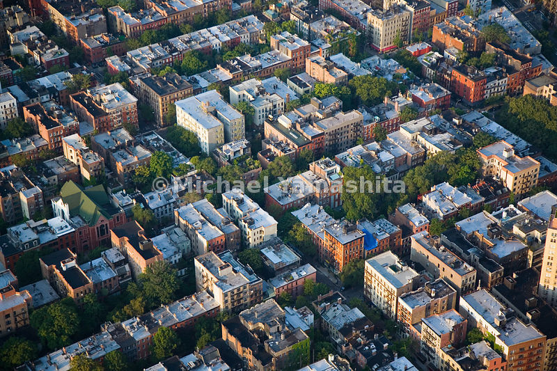 In addition to charming cobblestone streets and historic townhouses, Greenwich Village is also one of the greener areas of New York.  Trees and community gardens are abundant.  Manhattan, New York City.