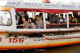 People taking water ferry along Chao Phraya River in Bangkok, Thailand.