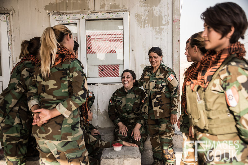 PAK (Kurdistan Freedom Party) female fighters With their Commander at their base north of Hawija, where Kurdish Iranian fighters are holding the line against the last vestiges of Daesh and preparing to engage the Hashd al Shaabi forces threatening Kirkuk. Kirkuk Governorate, Iraq, 14th October 2017