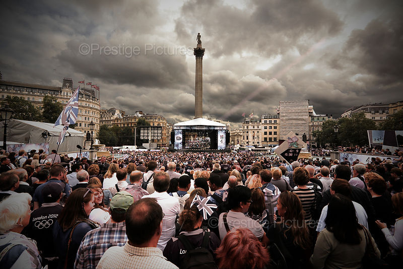 Crowds Mass in Trafalgar Square to watch the Athletes on a Large Video Screen