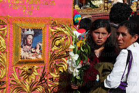 Devotees with embroidered banner at Corpus Christi festival , Cusco , Peru