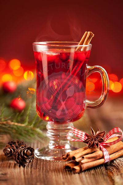 Hot mulled wine with berries, cinnamon sticks and anise