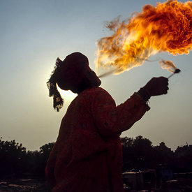 Vishal Bhatt breathes fire above the Kathputli slum, New Delhi