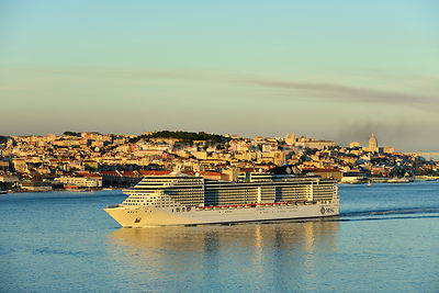 A cruise ship in the Tagus river. The historic centre of Lisbon in the background. Portugal