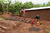 Making bricks from mud for a new house. Rwanda