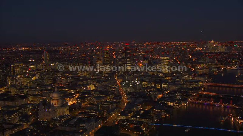 Aerial footage of St Paul's Cathedral and the City at night, London