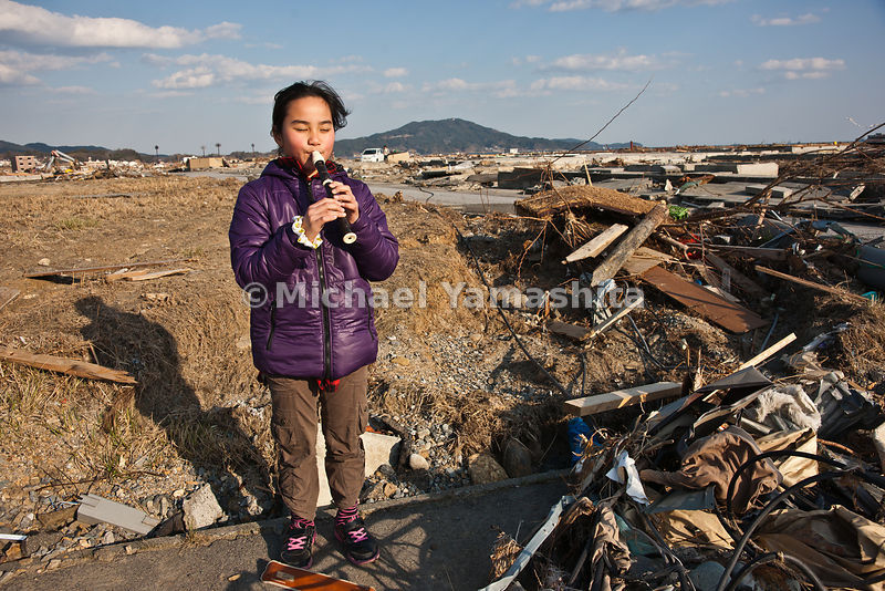 March 11 Great Eastern Japan Earthquake and Tsunami. Measuring 9, biggest ever to hit Japan destroying the NE coast line cities and villages for 200 plus miles. Kumi Murakami (090 6515 9220) and daughter Yayami 9 years old looking for her futon and spoon.  She was at her elementary school when the T. struck.  Mr. Shunichi Murakami 79 and wife Toshiko found her obi in the debris near the foundation of the home where they lived in a high priced neighborhood near the sea.