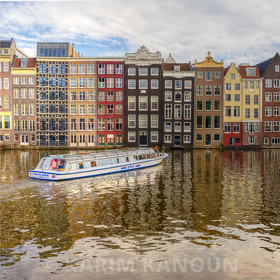 Colorful Amsterdam river reflection with a boat