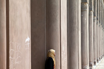 Egypt - Cairo - A young woman in a headscarf in the courtyard of the Ibn Tulun Mosque