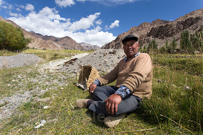 A farmer takes a midday siesta in Ney Village, Ladakh, India