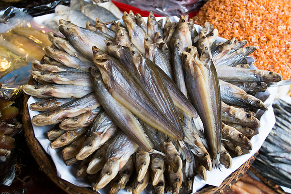 Basket full of dried fish at market