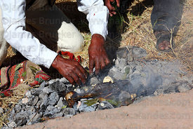 Shaman performing ritual to Pachamama (Mother Earth) before the rebuilding the bridge, Q'eswachaka , Canas province , Peru