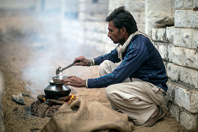 A man makes breakfast at the Pushkar Camel Fair, Pushkar, Rajasthan, India