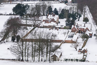 View from Hambledon Hill, iron age hill fort, over the snowy, delineated grounds of the Manor House, Child Okeford, north Dorset