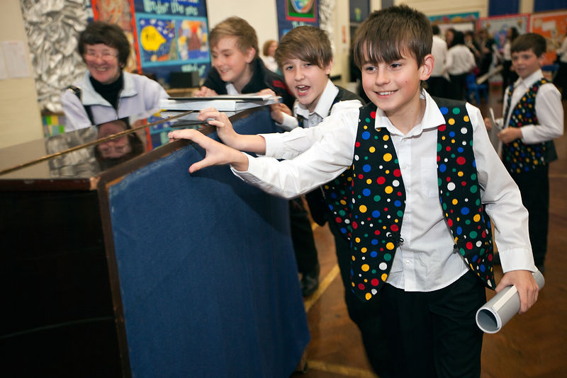UK - Scunthorpe - Schoolchildren help their music teacher push after auditions for singing parts in a production of Cycle Opera at Henderson Avenue Primary School