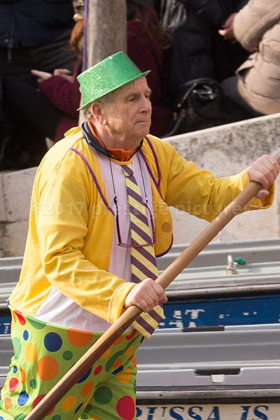 Man dressed as a Clown Rowing in the Venice Carnival Water Parade