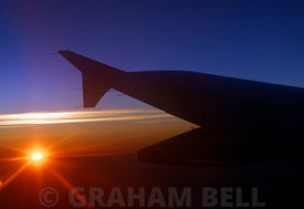 Wing of Aeroplane at sunset, Atlantic Ocean