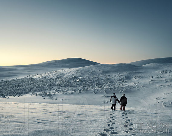 Couple walking in eerie snow landscape