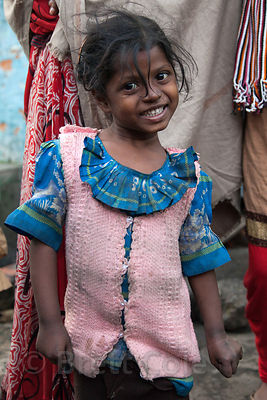 Portrait of a plucky girl in the Fakir Bagan neigborhood of Howrah, India, in an area served by the NGO Calcutta Kids (calcuttakids.org)