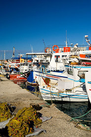 fishing boats moored in new harbour, san stefanos, north west, corfu, ionian islands, greece.