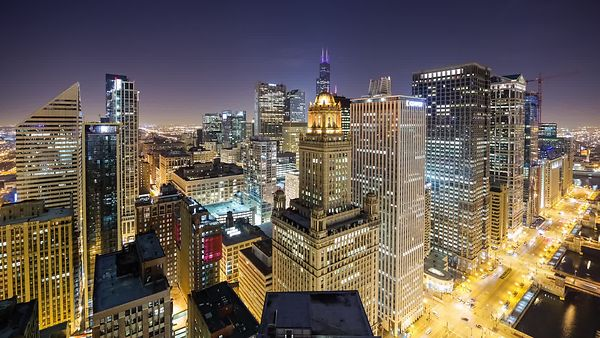 Bird's Eye: Wide Shot Looking Over A Mix of Modern & Art Deco High-rises During a Night Time Rush Hour