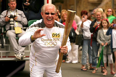 Thomas Kozlowicz Greeting Julie Darwin before Carrying the Olympic Torch