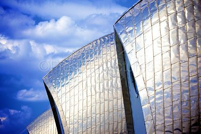 The Steel Cladding on the Thames Barrier Reflecting a Cloudy Blue Sky