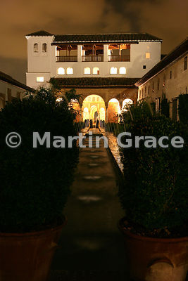The West Pavilion beyond the Patio de la Acequia (Water Garden) at night, Generalife, Granada, Andalusia, Spain