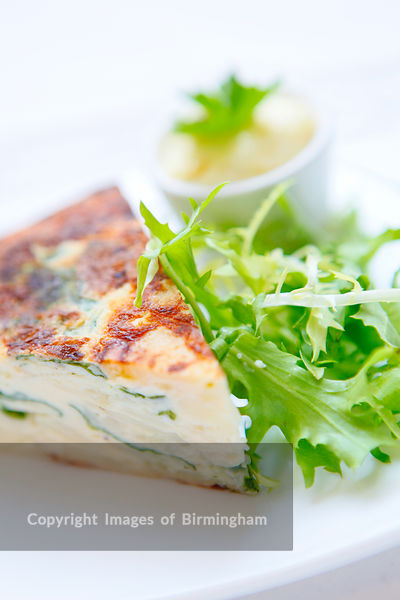 Quiche and salad served in th Ikon cafe, Brindleyplace, Birmingham, West Midlands, England
