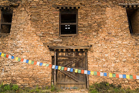 Prayer flags in front of the Drukgyal Dzong in Paro Bhutan.