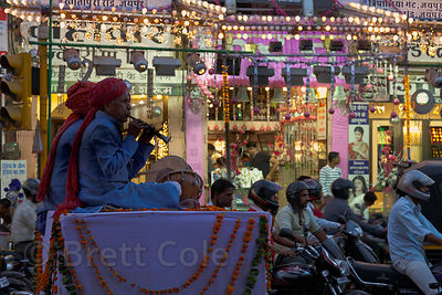 Musicians play on a fixed platform at a busy intersection during the Diwali festival in Jaipur, Rajasthan, India