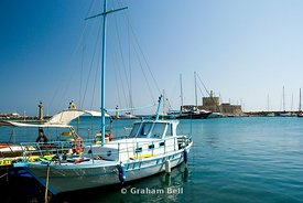 boats moored in mandraki harbour, rhodes town, rhodes, dodecanese islands, Greece..