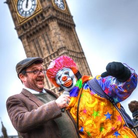 Frank Blunt Interviewing A Clown Outside Parliament
