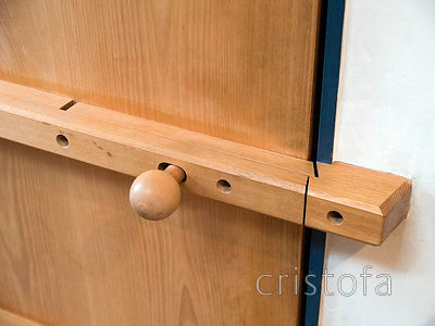 the upstairs doors were made of solid ash and the latches were incorporated into the battens
