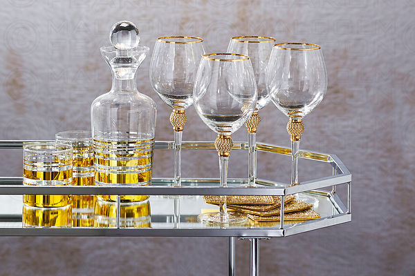 decanter with glasses on bar cart