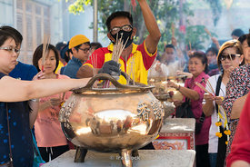 Incense sticks being handed out in Chinatown in Bangkok on the eve of Chinese Nea Year.